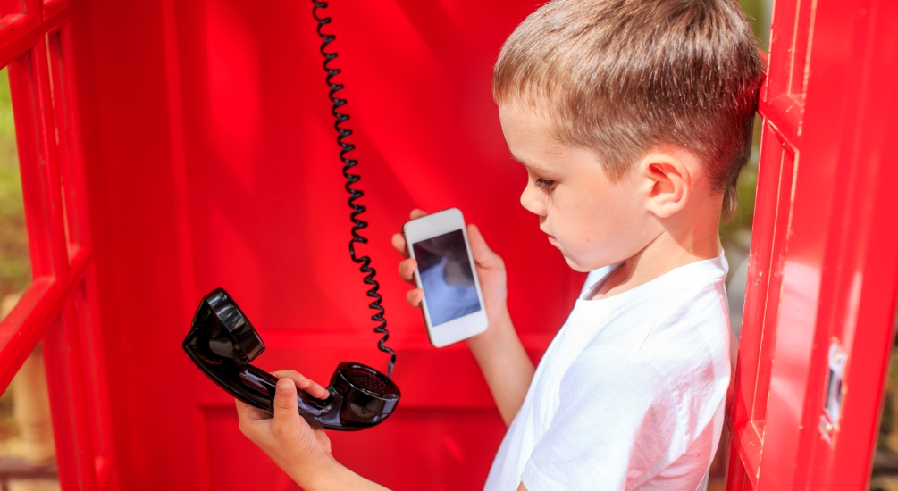 Social Media Marketing Services in Connecticut-Kid in a Red Phone Booth